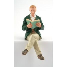 Sedící muž s knihou